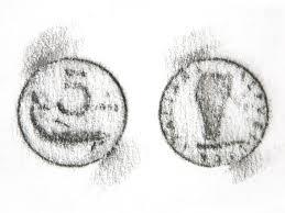 Monete realizzate con il frottage.